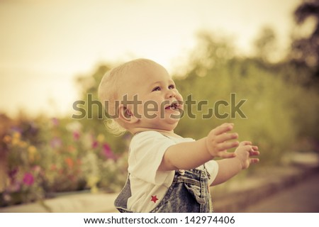 The little boy in the park - stock photo