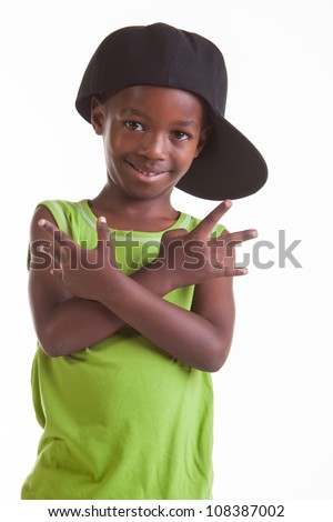 The little boy is dancing with the moves he was told. - stock photo