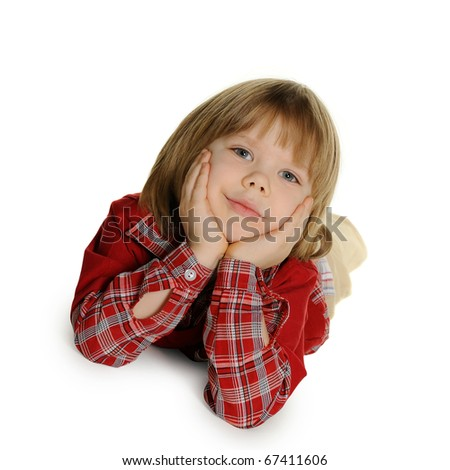 The little boy lays on a floor. It is isolated on a white background