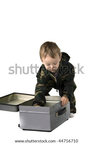 The little boy plays with the toys - stock photo