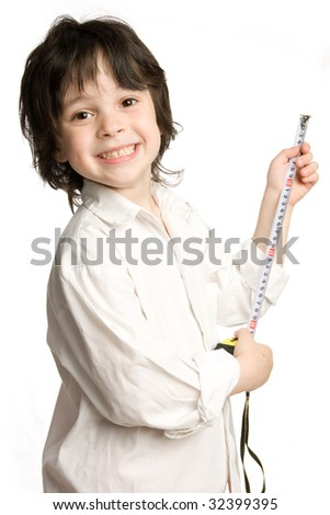 The little boy wish  long tape-measure - stock photo