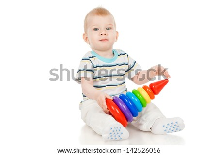 The little boy with a toy pyramid, isolated on white - stock photo