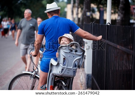 the little boy with the father by bicycle - stock photo