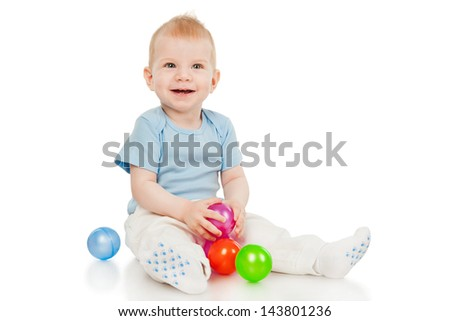 The little boy with toy balls - stock photo