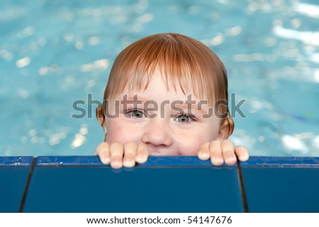 the little child in swimming pool - stock photo