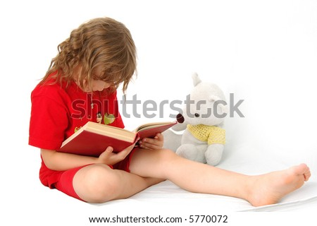 The little girl and bear reads the book - stock photo