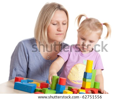 the little girl and her mother playing with toy blocks - stock photo