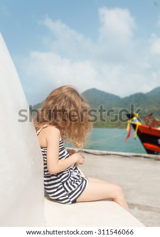 the little girl and the boat - stock photo