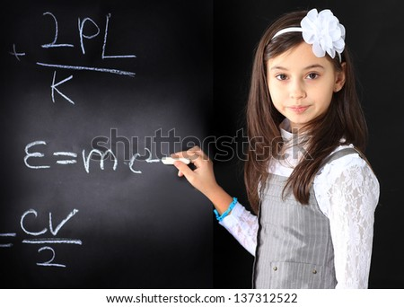 The little girl decides to mathematical equations.