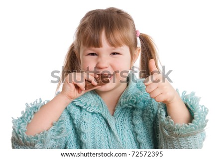 The little girl eats chocolate isolated on white background - stock photo
