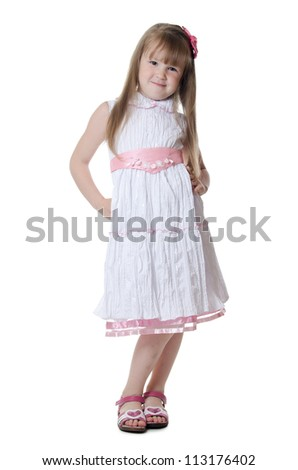 The little girl in a beautiful dress - stock photo