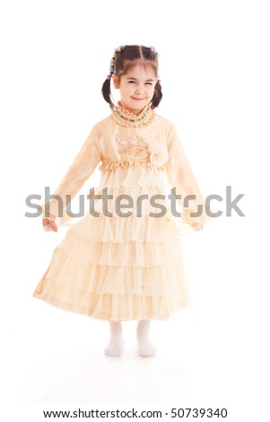 The little girl in a dress isolated on a white background - stock photo