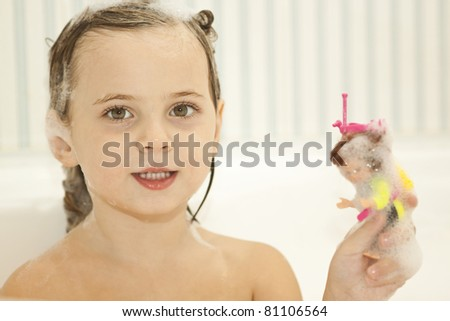 The little girl in the bathroom - stock photo