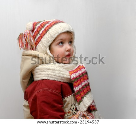 The little girl in winter clothes