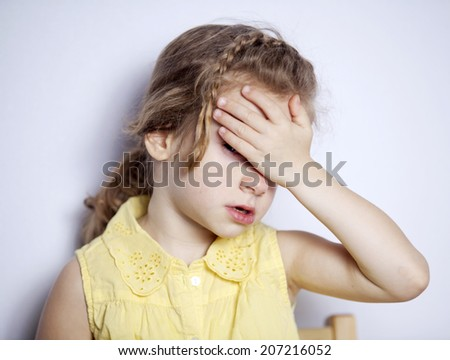 the little girl is sad and closes her eyes - stock photo