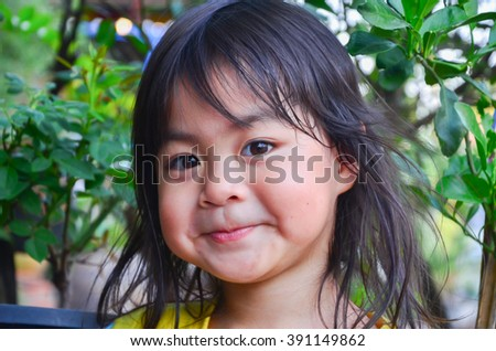 The little girl's face and the camera selective focus. - stock photo
