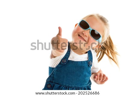 the little girl showing thumbs up - stock photo