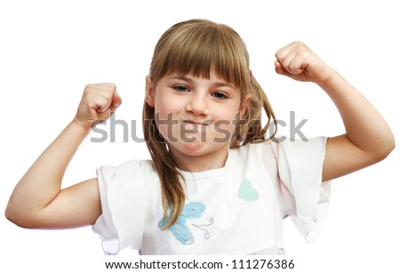 The little girl shows that she is strong - stock photo
