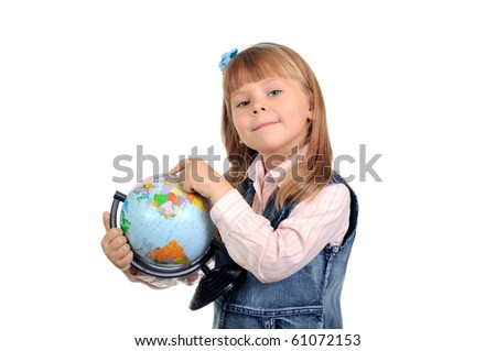 The little girl studies the globe