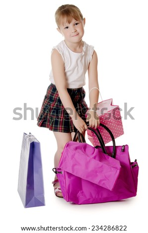 The little girl with a lilac bag - stock photo