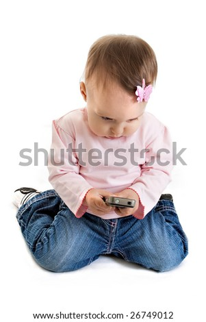 The little girl with a mobile phone - stock photo