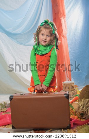 The little girl with a suitcase