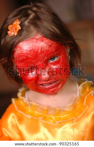 The little girl with cosmetics on the person a aggression - stock photo