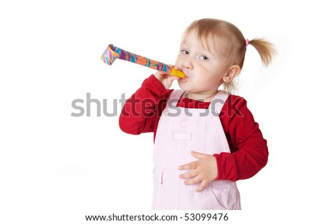 the little girl with party blower - stock photo