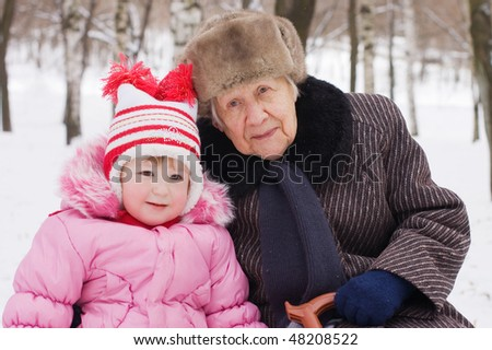 The little girl with the grandmother - stock photo