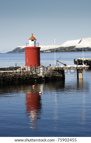 The little red lighthouse and jetty at Alesund, Norway
