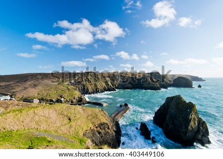 The Lizard coastline from cliffs above Mullion Cove in Cornwall - stock photo