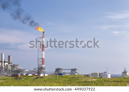 The LNG plant on Sakhalin, smoke from the chimneys in the sky