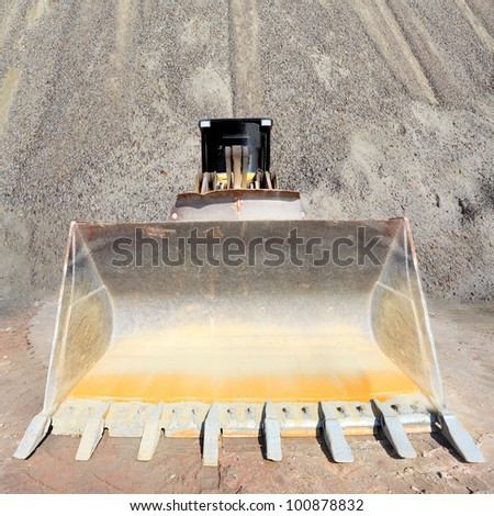 The loader excavator in a mine. - stock photo