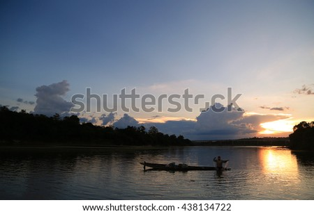 The locals are fishing. Evening on the Mun River, Ubon Ratchathani, Thailand. Local Long tail boat in the Mun River, Thailand.
