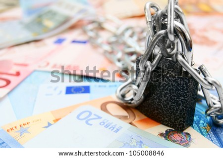 The lock, chain and money. - stock photo