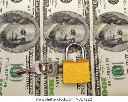 The lock with keys on  background of dollars,  close up - stock photo
