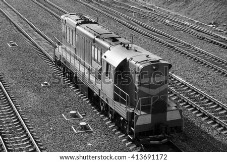 the locomotive is on the tracks black and white - stock photo