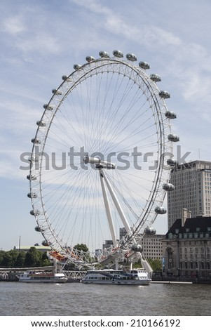 The London Eye is a giant Ferris wheel situated on the banks of the River Thames, in London, England, United Kingdom. 2014, june 21th. - stock photo