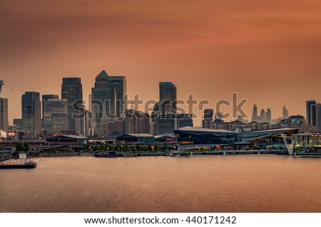 The London skyline at sunset with the skyscrapers from The City of London ( London'??s financial center) and the skyline of Canary Wharf ( Isle of Dogs, Docklands) - stock photo