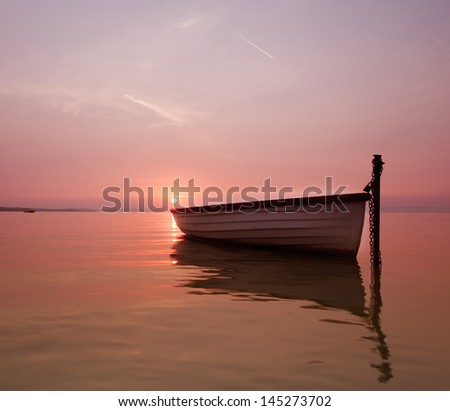 The lonely boat on the lake - stock photo
