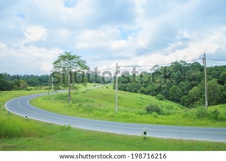 The Long Road on the Khao Yai National Park, Nakhon Ratchasima, Thailand - stock photo