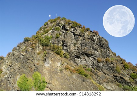 The Lorelei rock and big moon (German Loreley 132 m) is a 433 ft high steep slate rock on the right bank of the River Rhine in the Rhine Gorge at Sankt Goarshausen in Germany.