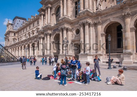 The Louvre Museum, Paris - June 26, 2013 : Teacher and a group of children on a field trip - stock photo