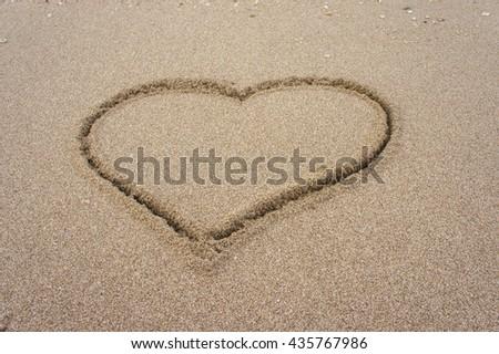 The love heart draw on the beach - stock photo