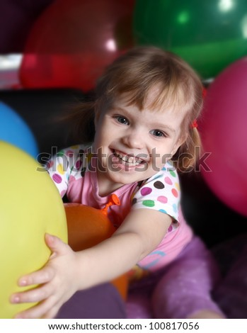 The lovely girl lies among balloons