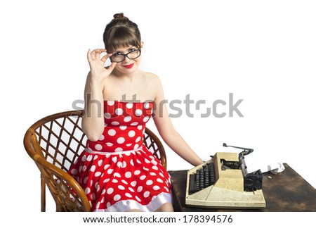 The lovely girl the writer with a typewriter on a white background - stock photo