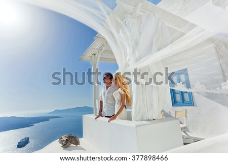 The lovely young couple beautiful woman from handsome man relating to the beautiful Greek landscape - stock photo