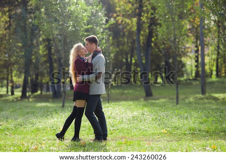 the lovers kissing in the park in spring