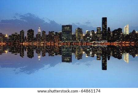 The Lower Manhattan Skyline with serious reflections in New York City. - stock photo