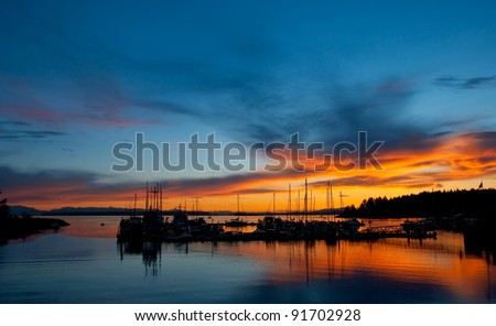 The Lund Harbor, Powell River, British Columbia, with a beautiful sunset and silhouette. - stock photo